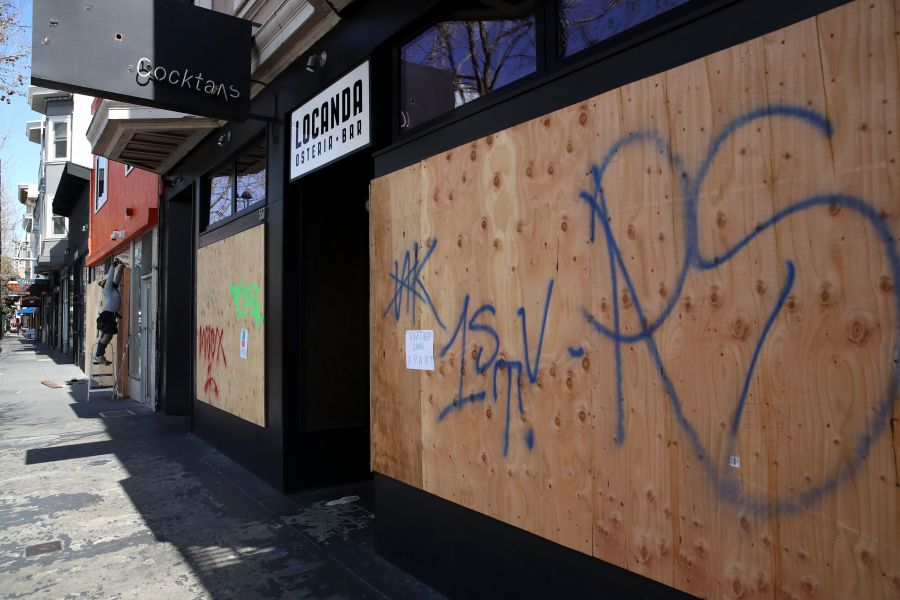 <who>Photo Credit: Getty Images</who>Many San Francisco businesses are boarding up their windows while closed to discourage looters.