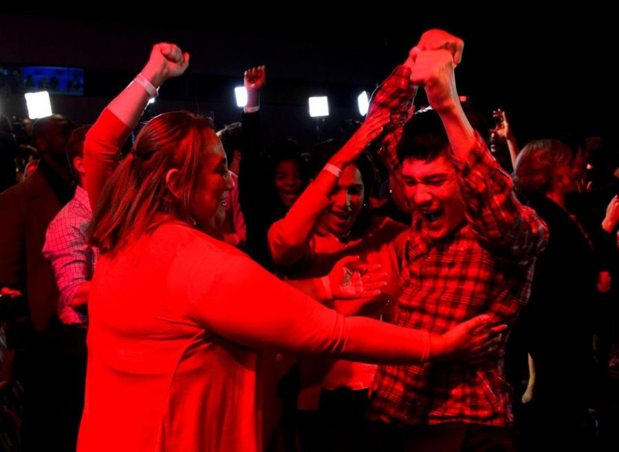 <who>Photo Credit: The Canadian Press</who>Liberal supporters celebrate on Monday night.